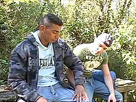 A kinky gay gets fucked by a muscular black stud in the garden