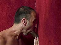 Steven Richards enjoys sucking and rubbing a gloryhole boner