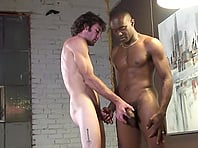 Brown-haired twink gives a handjob to black poofter