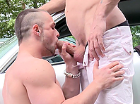 Muscular gay studs Franc Zambo and Just Angelo enjoy banging on a road