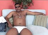 Chubby black gay daddy enjoys rubbing his fat boner indoors
