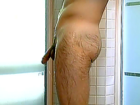 Gay bear takes a shower after jerking his weiner off