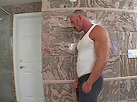 A twink gets his ass toyed and fucked by a daddy in the shower