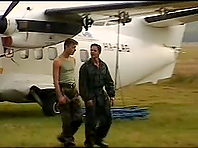 Two muscular homos pet each other and fuck in a plane