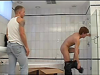 Gay hussy gives a blowjob and gets his ass drilled in a bathroom
