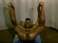 Black queer shows his well-rounded ass and masturbates his wang