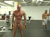 Tattooed homosexual gets his ass banged hard in a gym