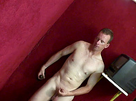 Kinky gay guy sucking a big black cock through a glory hole