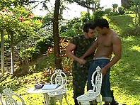 Hunky gay guy with an awesome body enjoying a bareback ass fuck in his garden