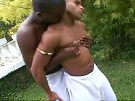 Ebony-skinned gay guy with a hot body enjoying a hardcore ass fuck in his garden
